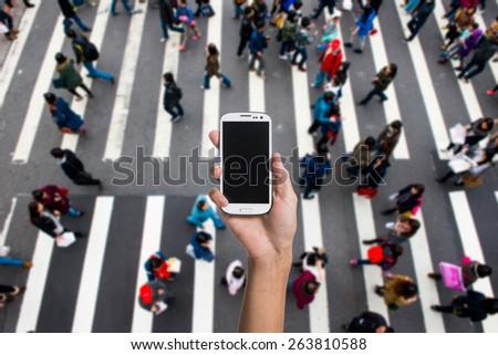 Using smartphone in the street - stock photo
