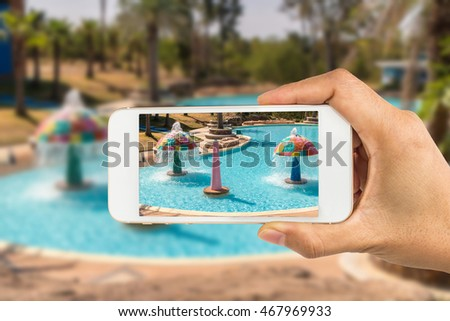 Using smartphone to take photos of Swimming Pool