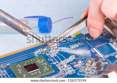 Using soldering tool for the computer parts. - stock photo