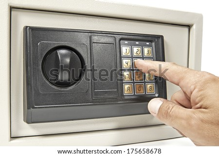 Using the code keypad on a safe - stock photo