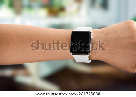 Using Touch Screen Smart Watch - stock photo