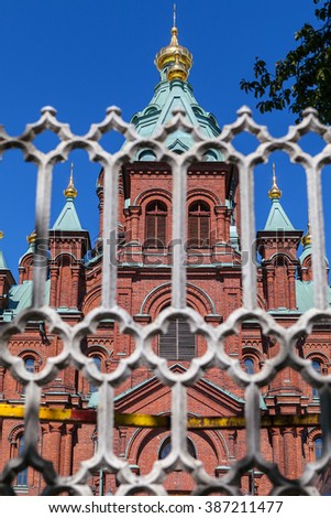 Uspenski Cathedral and fence At Summer Sunny Day. Red Church - Tourist destination In Finnish Capital