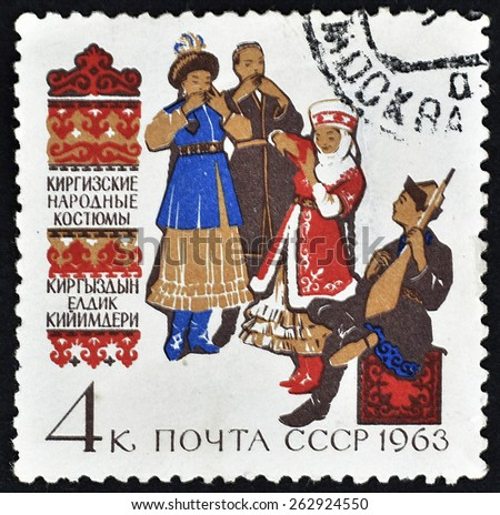 USSR - circa 1963: A post stamp printed in the USSR shows folk costumes of Kyrgyzstan, circa 1963. - stock photo