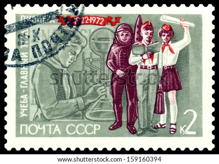 USSR-CIRCA 1972: A post stamp printed in USSR and shows Girl in Laboratory and Pioneers, series. Circa 1972.  - stock photo