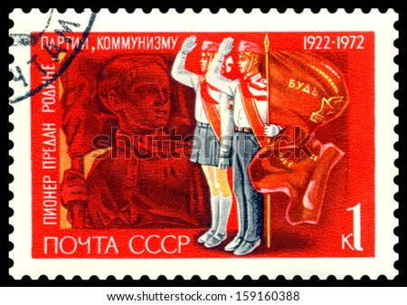 USSR-CIRCA 1972: A post stamp printed in USSR and shows Pavlik Morozov and pioneer beside banner of the pioneer organization, series. Circa 1972.  - stock photo