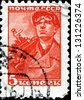 USSR - CIRCA 1929: A post stamp printed in USSR shows miner, circa 1929 - stock photo