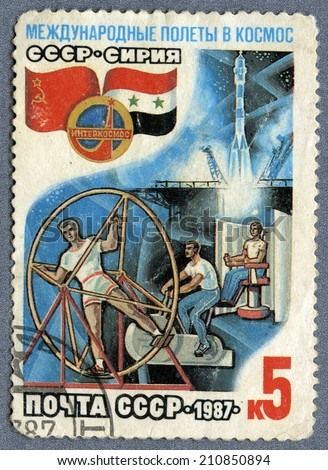 USSR - CIRCA 1987: A post stamp printed in USSR- The international space flights, circa 1987  - stock photo