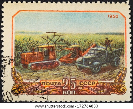 USSR - CIRCA 1956: A postage stamp printed in the USSR shows harvesting corn in collective farm peasantry in Soviet Russia, circa 1956 - stock photo