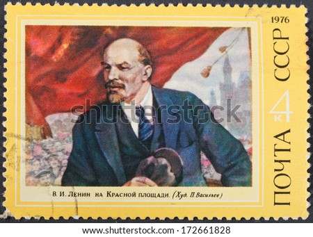 USSR - CIRCA 1976: A postage stamp printed in the USSR shows portrait of communist leader Lenin (Ulyanov) on meeting on Red Square, circa 1976 - stock photo