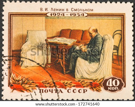 USSR - CIRCA 1954: A postage stamp printed in the USSR shows portrait of communist leader Lenin (Ulyanov) in working room, circa 1954 - stock photo