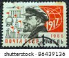 USSR - CIRCA 1966: A postage stamp printed in USSR shows Russian Marxist revolutionary and communist politician Vladimir Ilyich Lenin and the year of the October revolution (1917), circa 1966. - stock photo