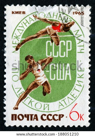 "USSR - CIRCA 1965: A stamp printed in the USSR (Russia) shows a athletes with the inscription and name of a series ""International match on track and field athletics, USSR - USA, Kiev,1965"", circa 1965 - stock photo"