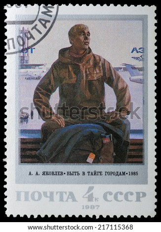 USSR- CIRCA 1987: A stamp printed in the USSR shows a picture of yearning young guy - the artist Yakovlev, circa 1987 - stock photo