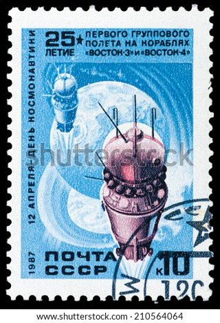 USSR - CIRCA 1987: A stamp printed in the USSR shows First group flight aboard Vostok, circa 1987 - stock photo