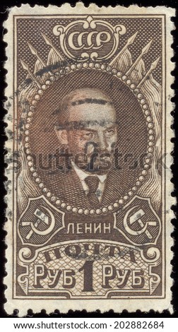 USSR -CIRCA 1925: A Stamp printed in the USSR shows V.I. Lenin, circa 1925 - stock photo