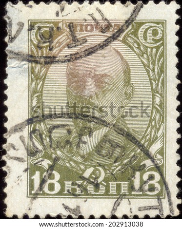 USSR -CIRCA 1927: A Stamp printed in the USSR shows V.I. Lenin, circa 1927 - stock photo