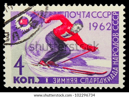 USSR - CIRCA 1962: A stamp printed in USSR,  first winter Olympics of the USSR, mountain slalom, skier, circa 1962 - stock photo