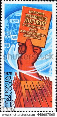 "USSR - CIRCA 1979: A stamp printed in USSR, inscription ""To conclude a world Treaty on the nonuse of force in international relations."" of the USSR, the hand raised up, circa 1979"