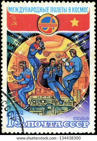 USSR-CIRCA 1980: A stamp printed in USSR, international flights into space, astronauts in space on Space Station are investigating, circa 1980