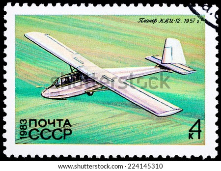 "USSR - CIRCA 1983: A Stamp printed in USSR (Russia) shows the Glider with the inscription ""KAJ-12"" 1957, from the series ""History of the Soviet Gliding"", circa 1983  - stock photo"