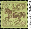 USSR - CIRCA 1971: A stamp printed in USSR shows a rider on a horse, about 1971 - stock photo