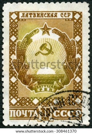 USSR - CIRCA 1947: A stamp printed in USSR shows Latvian Arms, devoted Latvian SSR, circa 1947 - stock photo