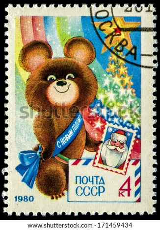 USSR - CIRCA 1980: A stamp printed in USSR shows Olympic Bear Holding Stamp - a symbol of the Moscow Olympics games, New Year 1980, circa 1980  - stock photo