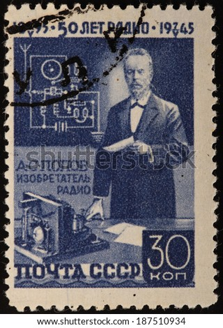 USSR - CIRCA 1945: A stamp printed in USSR shows portrait of man, name Popov, circa 1945 - stock photo