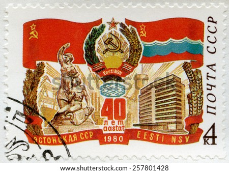 USSR - CIRCA 1980: A stamp printed in USSR shows Russian flag and arms, Estonian flag, monument, building, devoted Estonian SSR, 40th anniversary, circa 1980