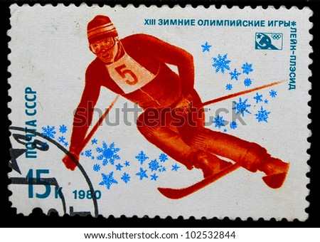 USSR - CIRCA 1980: A stamp printed in USSR, swimming, mountain slalom skier rides a mountain, Lake Placid, United States Winter Olympic Games, circa 1980 - stock photo