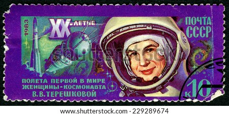 USSR - CIRCA 1983: A stamp printed in USSR, 20th anniversary of first flight into space , cosmonaut Valentina Tereshkova. ,circa 1983 - stock photo