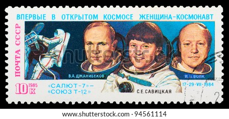 USSR - CIRCA 1985: An airmail stamp printed in USSR shows spacemen, series, circa 1985. - stock photo