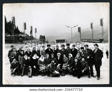 "Ussr - CIRCA 1977: An antique Black & White photo show Group of tourists. Caption for photo: ""Almaty, Medea, 1977"""