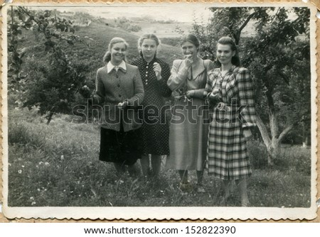 USSR - CIRCA 1951: An antique photo shows four young women are resters of SPA Sovetskiy, Grozniy, Chechnia, 1951