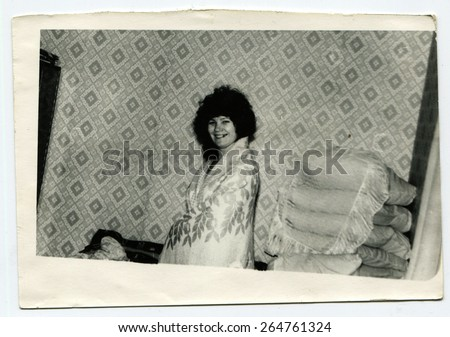 USSR - CIRCA 1957: An antique photo shows woman in bedroom