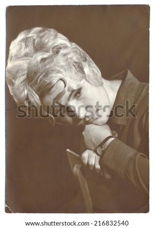 USSR - CIRCA 1962: an antique studio Portrait of a young beautiful sad woman, circa 1962 - stock photo