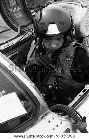 USSR - CIRCA 1976:  pilot, Lieutenant Valerii Poltoranin, connects to the avionics in the cockpit MiG-21, air base Kubinka, Moscow Region, USSR, July 1976 - stock photo