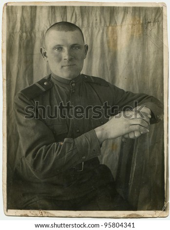 USSR - CIRCA 1944: Portrait of a soldier's Internal Troops - Soviet concentration camp guard, Narym, Tyumen region, Russia, circa 1944 - stock photo