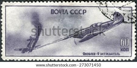 USSR - CIRCA 1945: Postage stamp showing the military battle aircraft Yakovlev-9. World War II. Circa 1945 - stock photo
