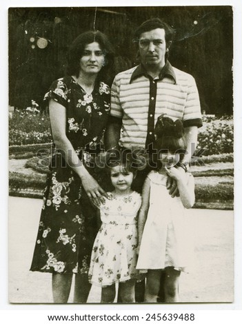Ussr - CIRCA 1980s: An antique Black & White photo show family for a walk in the park