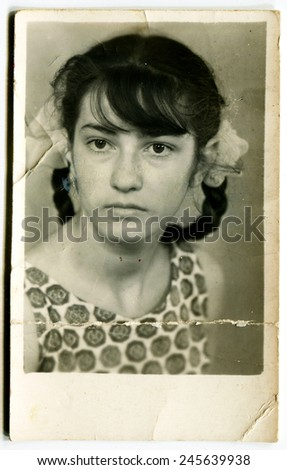 Ussr - CIRCA 1980s: An antique Black & White photo show girl with pigtails and bows - stock photo