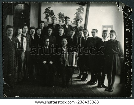 "Ussr - CIRCA 1930s: An antique Black & White photo show Group travelers. Caption for photo: ""Tyumen, Holiday House"""