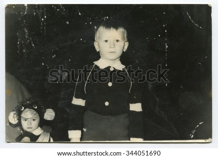 Ussr - CIRCA 1970s: An antique Black & White photo show  little boy standing under the Christmas tree - stock photo