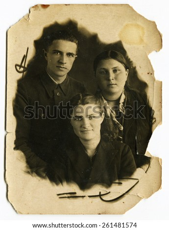Ussr - CIRCA 1950s: An antique Black & White photo show man and two woman - stock photo