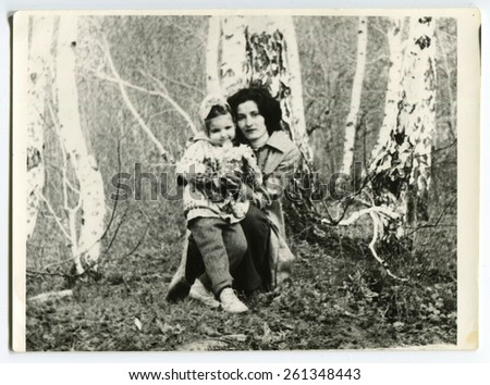 Ussr - CIRCA 1980s: An antique Black & White photo show mother and daughter in forest