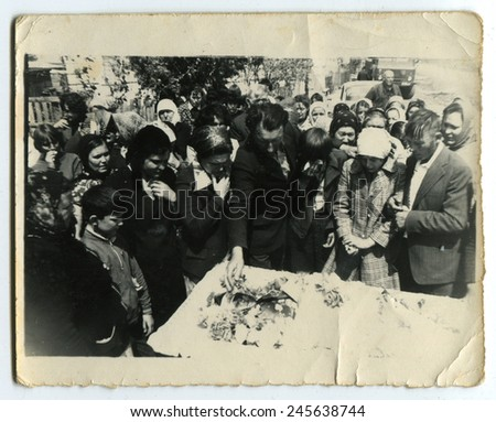 Ussr - CIRCA 1970s: An antique Black & White photo show People near the grave - stock photo