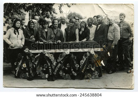 Ussr - CIRCA 1980s: An antique Black & White photo show People near the grave - stock photo