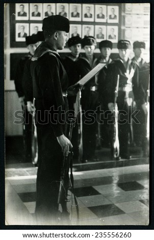 Ussr - CIRCA 1950s: An antique Black & White photo show soldier sailor takes the oath of allegiance