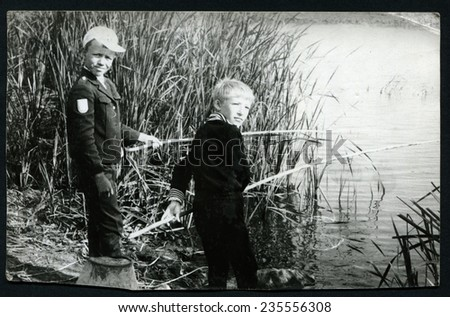 Ussr - CIRCA 1950s: An antique Black & White photo show two little boys on a fishing trip