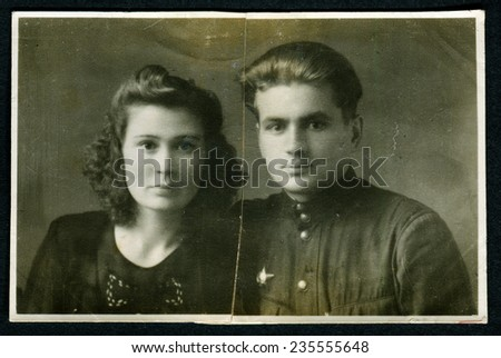 Ussr - CIRCA 1950s: An antique Black & White photo show Young family - a husband and wife - stock photo